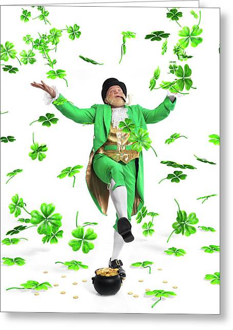 Leprechaun Tossing Shamrock Leaves Up In The Air Greeting Card by Oleksiy Maksymenko