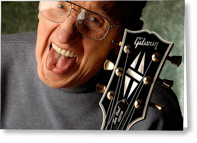 Les Paul With Tongue Out By Gene Martin Greeting Card