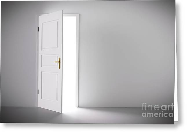 Light Coming From Half Open Classic White Door. Greeting Card by Michal Bednarek