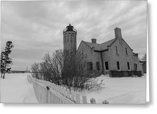 Greeting Card featuring the photograph Lighthouse And Mackinac Bridge Winter Black And White  by John McGraw