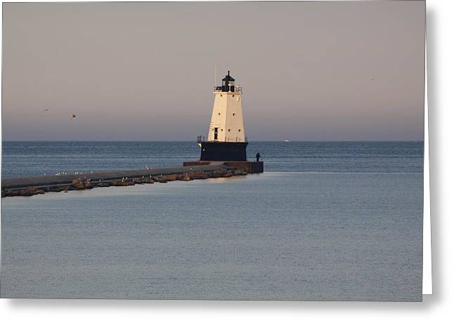 Lighthouse At Sunset Greeting Card by Chuck Bailey