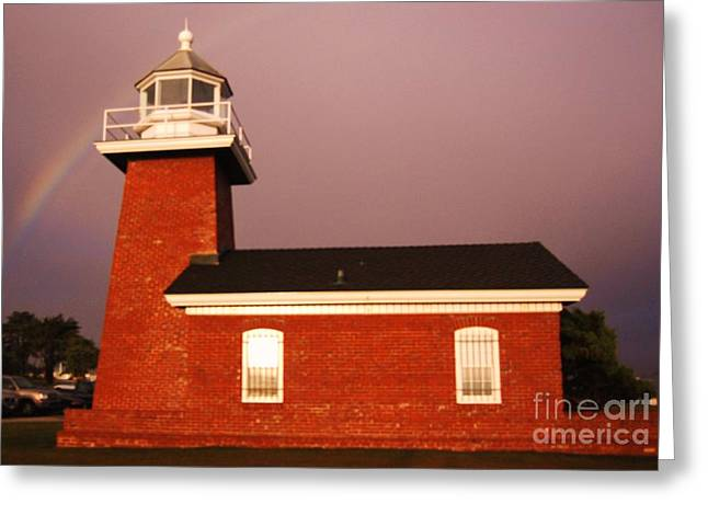 Lighthouse In A Rainbow Greeting Card by Garnett  Jaeger