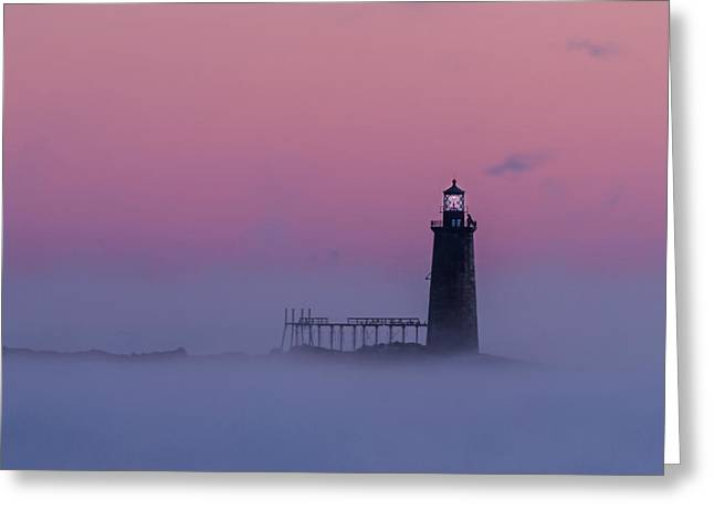 Lighthouse In The Clouds Greeting Card