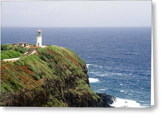 Lighthouse On A Cliff Kileaua Lighthouse Greeting Card by George Oze