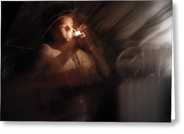Greeting Card featuring the photograph Lighting The Cigarette by Karen Musick