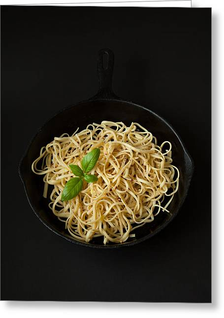 Linguine In A Cast Iron Pan With Basil On Black Background Greeting Card