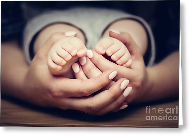 Little Baby Feet In Mother's Hands. Child Care, Feeling Safe, Protect. Greeting Card by Michal Bednarek