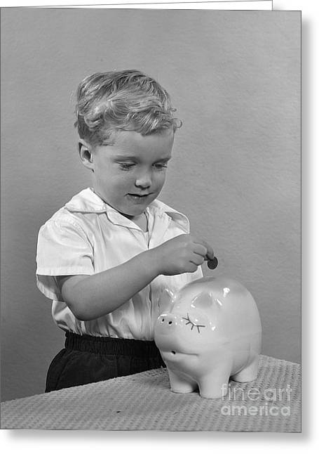 Little Boy Putting Coin Into Piggy Greeting Card by H. Armstrong Roberts/ClassicStock