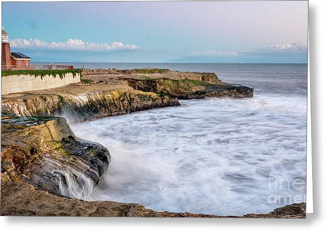 Long Exposure Of Waves Against The Cliff With Lighthouse In Shot Greeting Card
