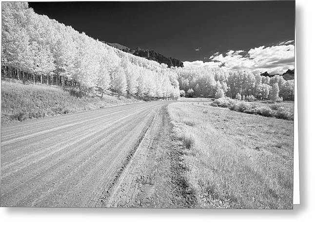Greeting Card featuring the photograph Long Road In Colorado by Jon Glaser