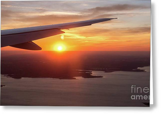 Looking At Sunset From Airplane Window With Lake In The Backgrou Greeting Card