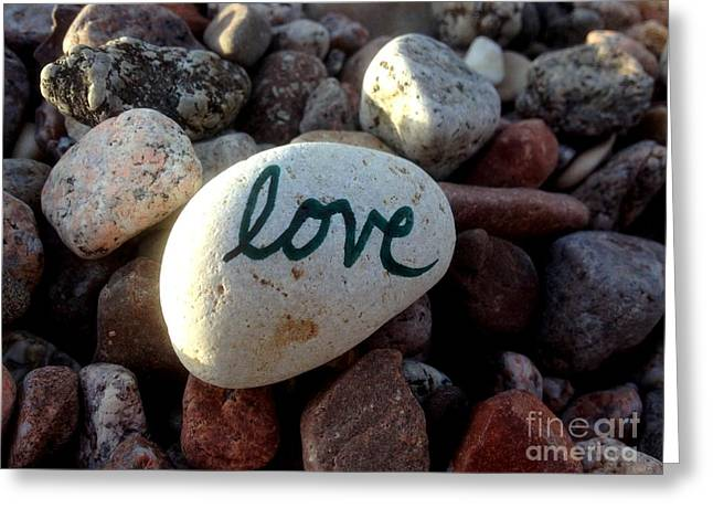 Love On Stone Greeting Card by Noa Yerushalmi