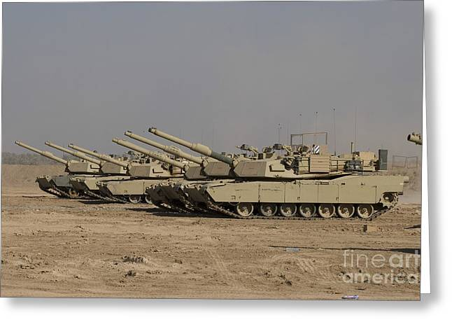 M1 Abrams Tanks At Camp Warhorse Greeting Card by Terry Moore