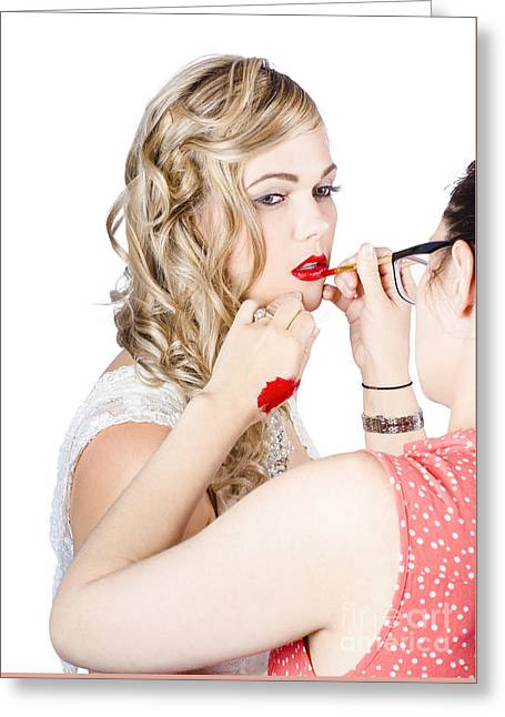Make-up Artist Applying Lipstick On A Model Greeting Card