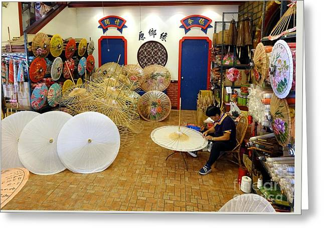 Greeting Card featuring the photograph Making Chinese Paper Umbrellas by Yali Shi
