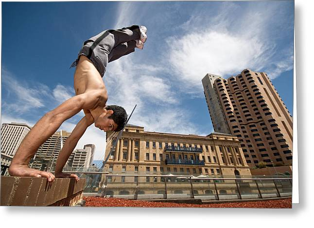 Male Gymnast Does A Handstand Greeting Card by Brooke Whatnall