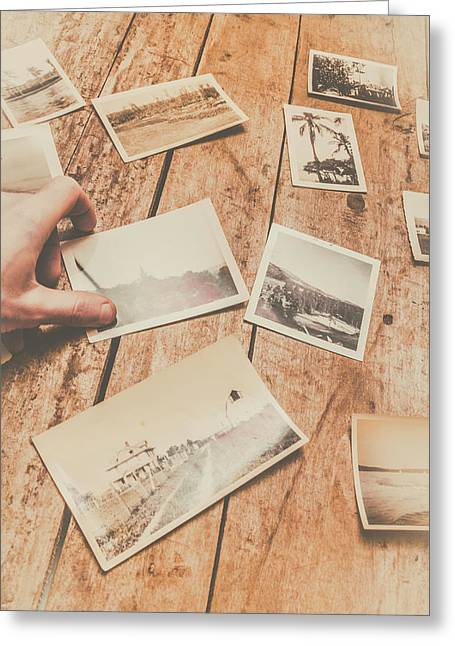 Male Hand Holding Instant Photo On Wooden Table Greeting Card by Jorgo Photography - Wall Art Gallery