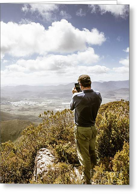 Male Tourist Taking Photo On Mountain Top Greeting Card