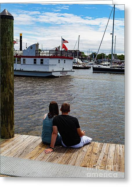 Man And Woman Sitting On Dock Greeting Card
