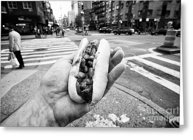man holding chilli hot dog street food in New York City USA Greeting Card