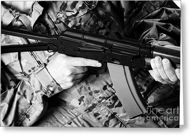 Man In Combat Fatigues Holding Aks-47u Close Quarter Combat Kalashnikov Rifle Greeting Card by Joe Fox