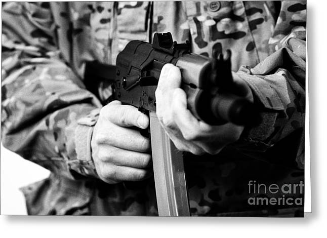 Man In Combat Fatigues Holding Aks-47u Close Quarter Combat Kalasknikov Rifle Focus On Safety Select Greeting Card