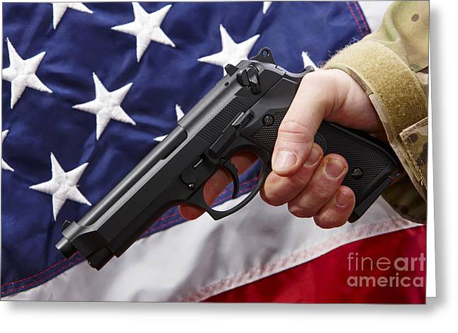 Man In Fatigues Holding Beretta Handgun In Front Of United States Of America Flag Greeting Card by Joe Fox