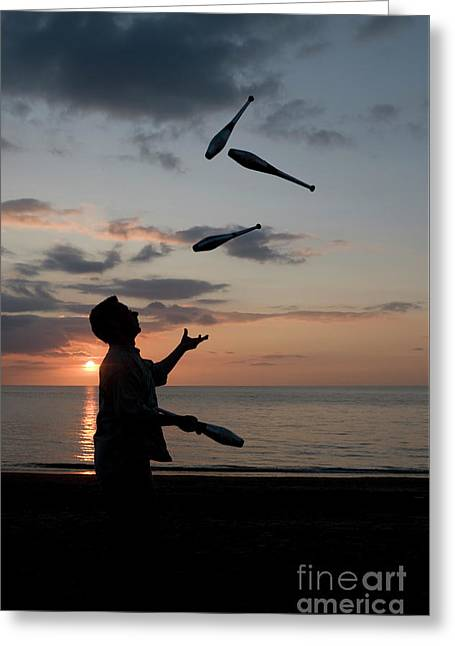 Man Juggling With Four Clubs At Sunset Greeting Card
