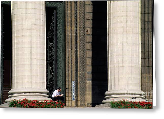 Man Reading A Book Beside The Columns Of La Madeleine Church In Paris Greeting Card by Sami Sarkis