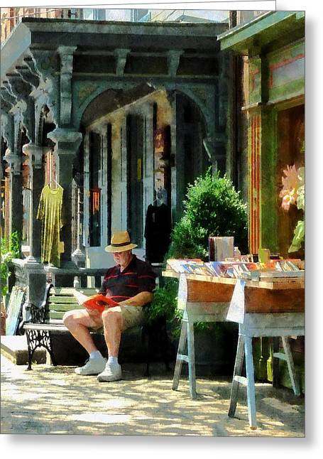 Man Reading By Book Stall Greeting Card