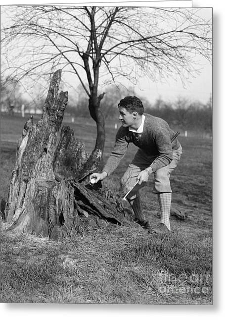 Man Retrieving Golf Ball From Tree Greeting Card by H. Armstrong Roberts/ClassicStock