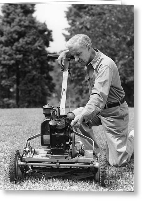 Man Tinkering With Lawnmower, C.1940s Greeting Card by H. Armstrong Roberts/ClassicStock