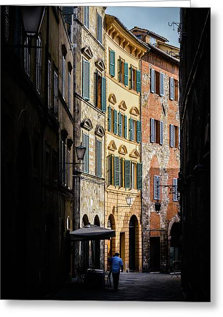 Man Walking Alone In Small Street In Siena, Tuscany, Italy Greeting Card