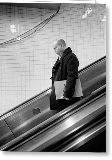 Greeting Card featuring the photograph Man With Envelope On Escalator by Dave Beckerman