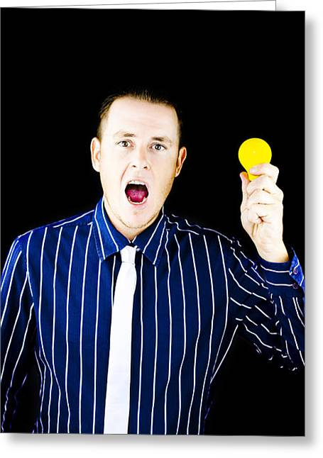 Man With Open Mouth Holding Yellow Bulb Greeting Card by Jorgo Photography - Wall Art Gallery