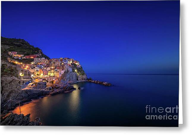 Greeting Card featuring the photograph Manarola Village During Blue Hour At Night by IPics Photography