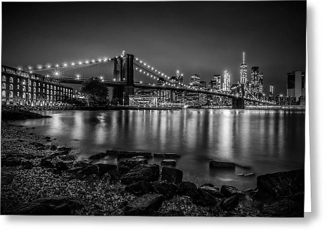 Manhattan Skyline And Brooklyn Bridge Nightly Stroll Along The River Bank  Greeting Card