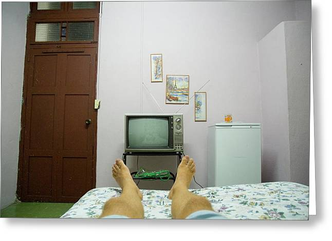 Man's Legs On A Bed In Front Of An Old Tv Greeting Card by Sami Sarkis