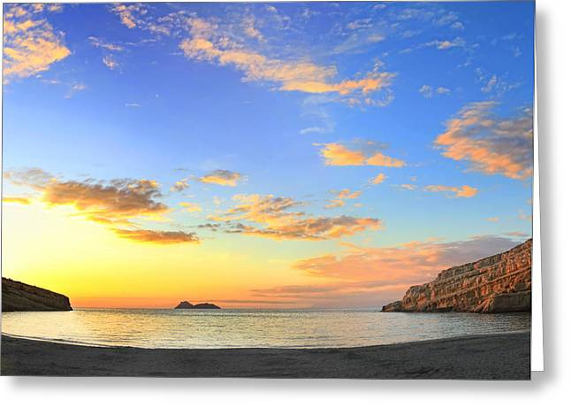 Matala Bay Sunset Greeting Card by Paul Cowan