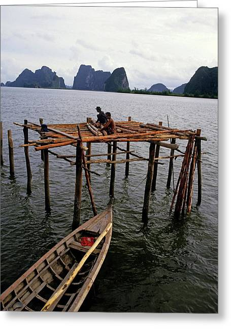 Stilt House Greeting Cards - Men constructing a pile dwelling in Thailand Greeting Card by Sami Sarkis