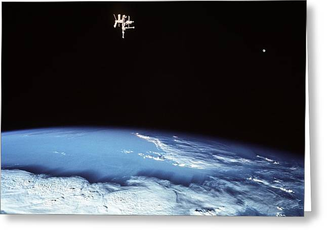 Mir Space Station Over The Earth Greeting Card by NASA / Science Source