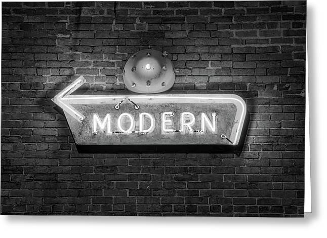 Modern Arrow Neon Sign On Brick Wall - Black And White Greeting Card by Gregory Ballos