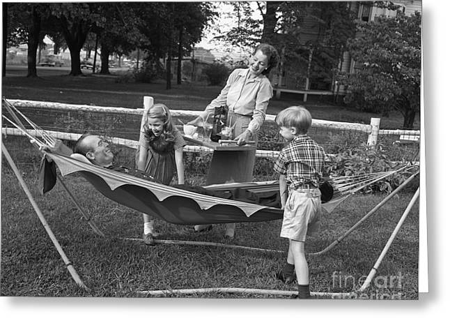 Mom And Kids Serving Dad In Hammock Greeting Card