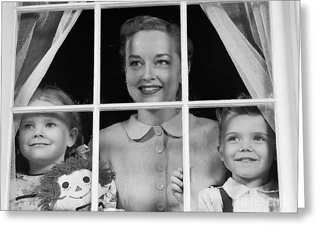 Mom With Two Kids Looking Out Window Greeting Card by H. Armstrong Roberts/ClassicStock
