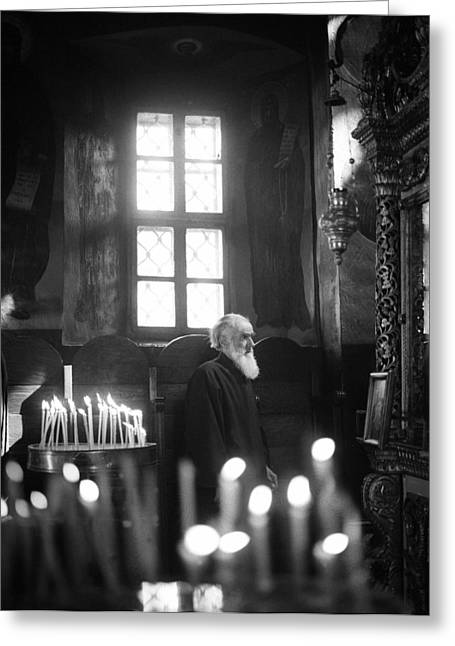 Monk And Candles Greeting Card by Emanuel Tanjala