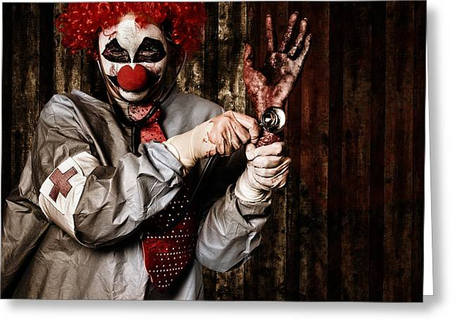 Monster Clown Checking The Pulse On A Severed Hand Greeting Card by Jorgo Photography - Wall Art Gallery