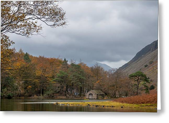 Moody Clouds Over A Boathouse On Wast Water In The Lake District Greeting Card