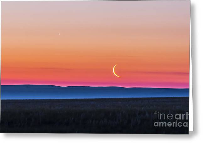 Moon And Venus Rising Over The Flat Greeting Card by Alan Dyer