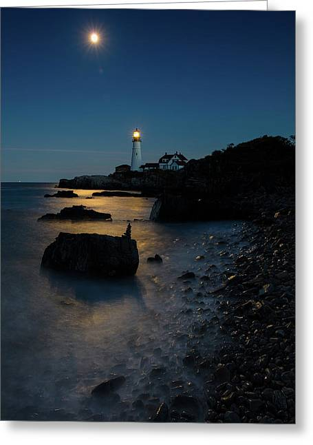 Greeting Card featuring the photograph Moon Light Over The Lighthouse  by Emmanuel Panagiotakis