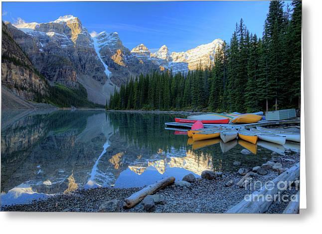 Moraine Lake Sunrise Blue Skies Canoes Greeting Card by Wayne Moran